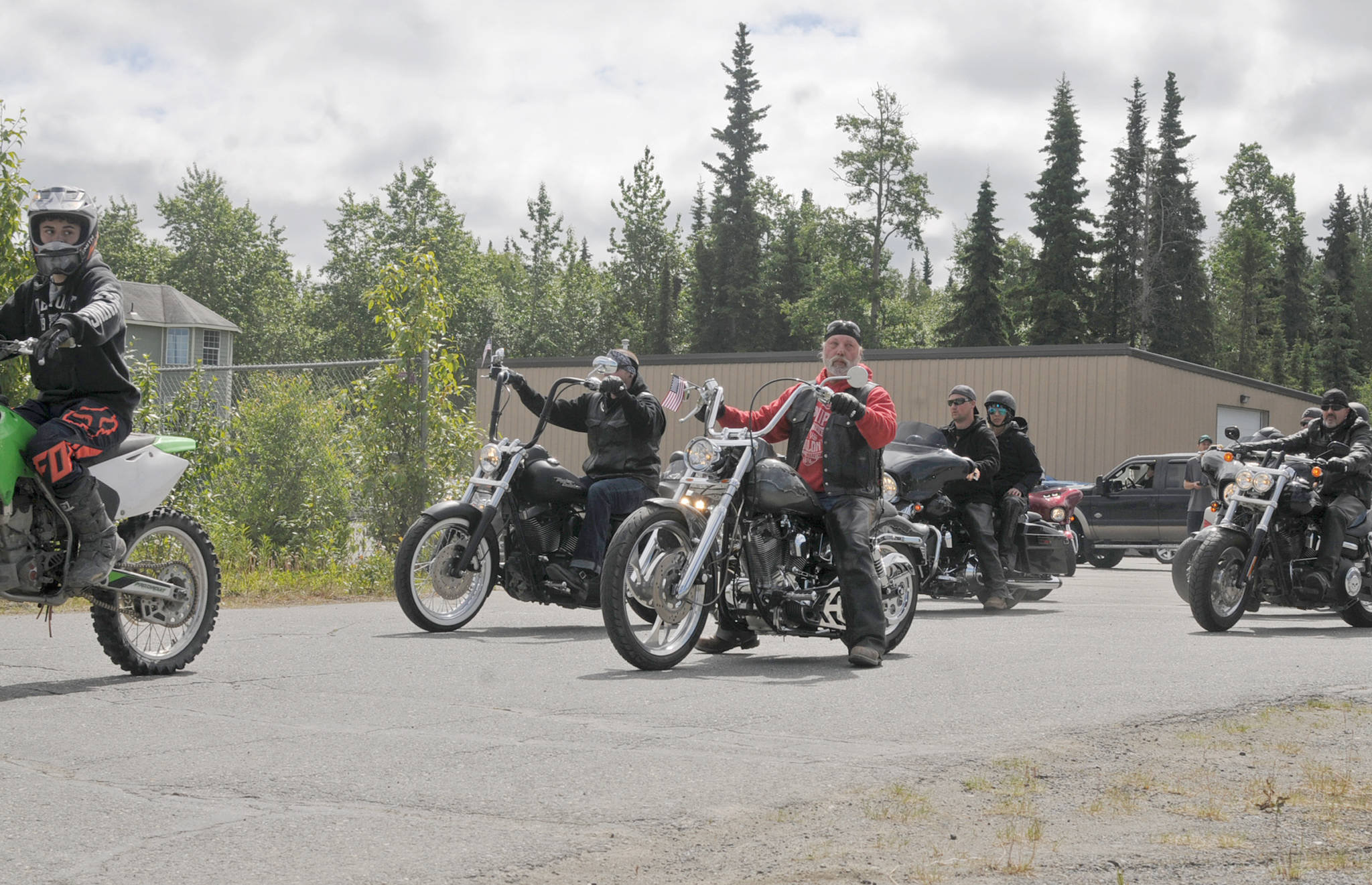 Motorcyclists line up as part of a procession to Travis Stubblefield's memorial service at the driveway of the Harley-Davidson Motorcycles store on Saturday, June 30, 2018 in Soldotna, Alaska. Stubblefield, a lifelong resident of the Soldotna area, was killed June 21 in a conflict in Kasilof. Alaska State Troopers are investigating the circumstances of his death, though no charges have yet been filed. (Photo by Elizabeth Earl/Peninsula Clarion)