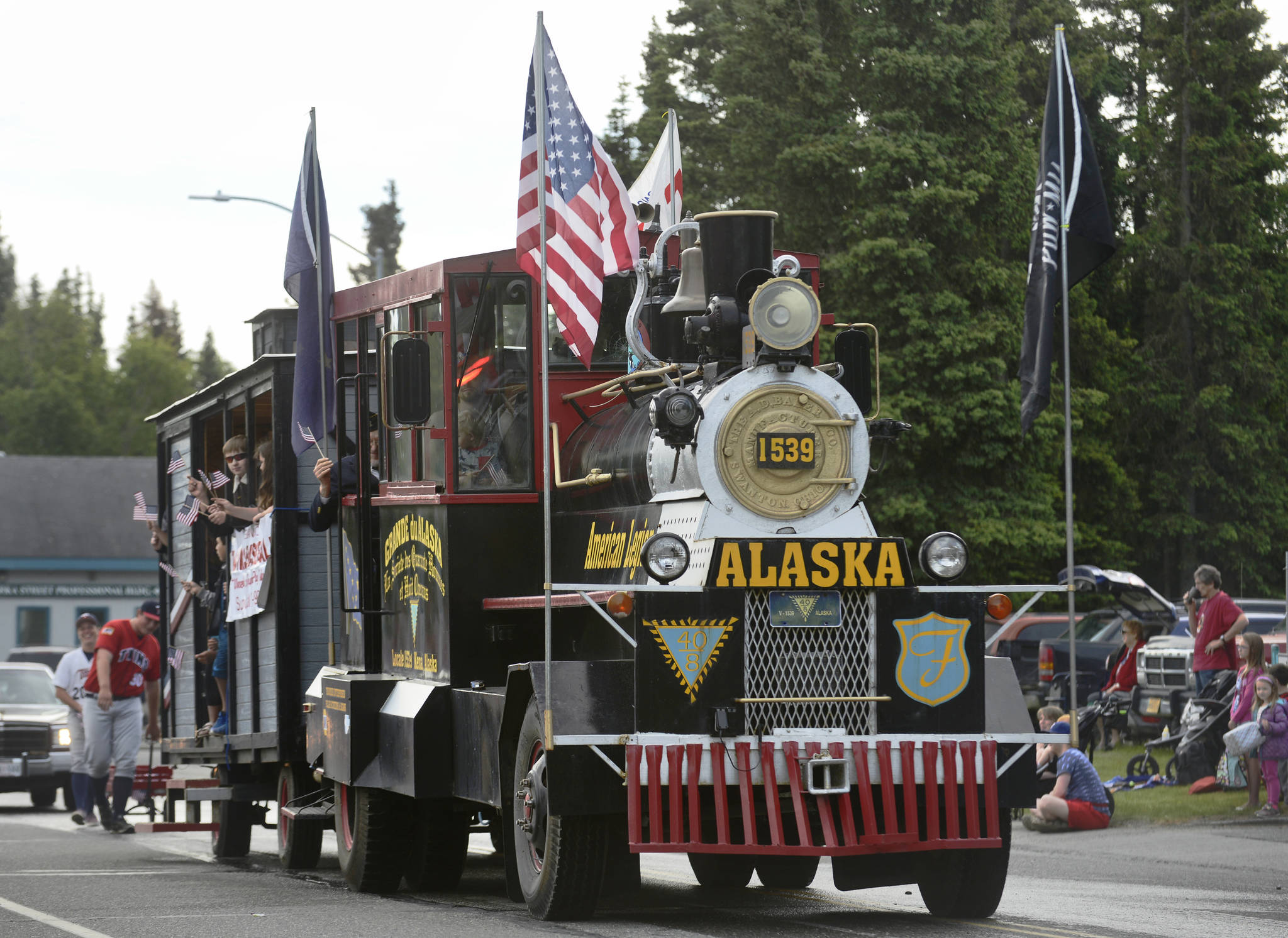 Kenai's American Legion Post 20 drives their truck remodeled as a steam locomotive during Kenai's Fourth of July parade on Wednesday, July 4, 2018 in Kenai, Alaska. Aboard are members of the Legion-sponsored Twins baseball team. (Ben Boettger/Peninsula Clarion)                                   Snare drummers from Kenai Central High School's drumline perform in the Kenai's Fourth of July parade on Wednesday, July 4, 2018 in Kenai, Alaska. (Ben Boettger/Peninsula Clarion)                                  Wildland firefighters from the Alaska Division of Forestry march in Kenai's Fourth of July parade on Wednesday, July 4 in Kenai, Alaska. (Ben Boettger/Peninsula Clarion)