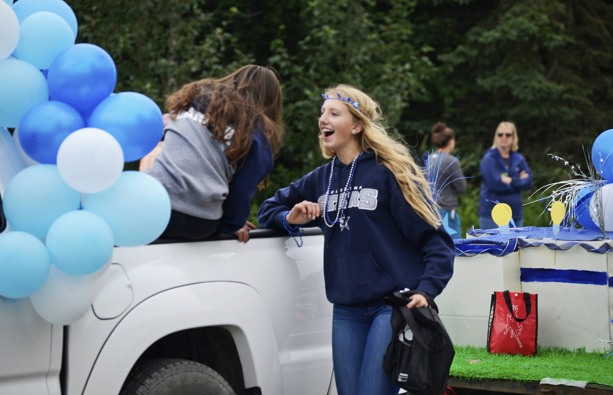 Participants in Soldotna High School's float in the Progress Days parade chat as they make their way down Marydale Avenue on Saturday, July 28, 2018 in Soldotna, Alaska. The parade kicks off the weekend-long event celebrating Soldotna's history, with a market on Saturday and Sunday in Soldotna Creek Park and a concert Saturday night followed by a free community barbecue Sunday. (Photo by Elizabeth Earl/Peninsula Clarion)