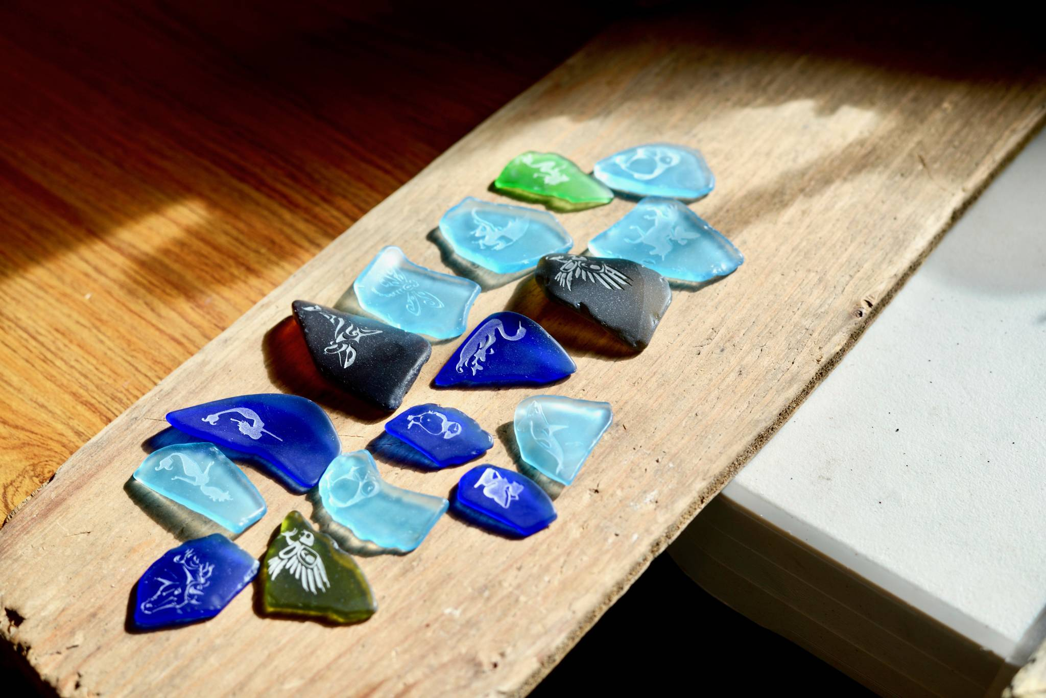Alaska Sea Glass now offers etching services on their glass pendants on Friday, July 27, 2018, in Nikiski, Alaska. (Photo by Victoria Petersen/Peninsula Clarion)