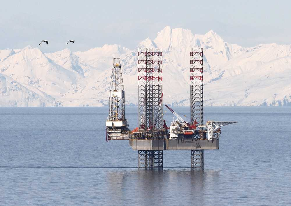 Photo by Brian Smith/Peninsula Clarion The Endeavour-Spirit of Independence jack up rig, seen here in early April at the Cosmopolitan site near Anchor Point, has spudded its first well nine months after it arrived in Cook Inlet from Singapore in mid-August 2012. Buccaneer said it would drill to a depth of 8,000 feet to test for oil and gas on the site. Drilling is expected to take 45 days.
