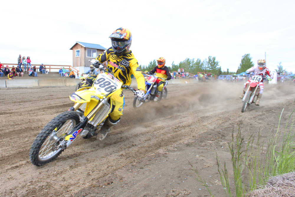Photo by Kelly Sullivan/ Peninsula Clarion Racers right off the jump at the State Races, Saturday, at Twin City Raceway.