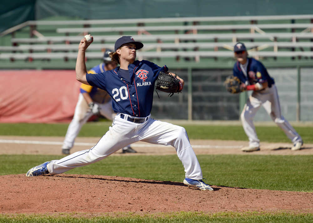 Photo by Rashah McChesney/Peninsula Clarion  Klayton Justice pitches during a Twins game against Bartlett Saturday July 19, 2014 in Kenai, Alaska.