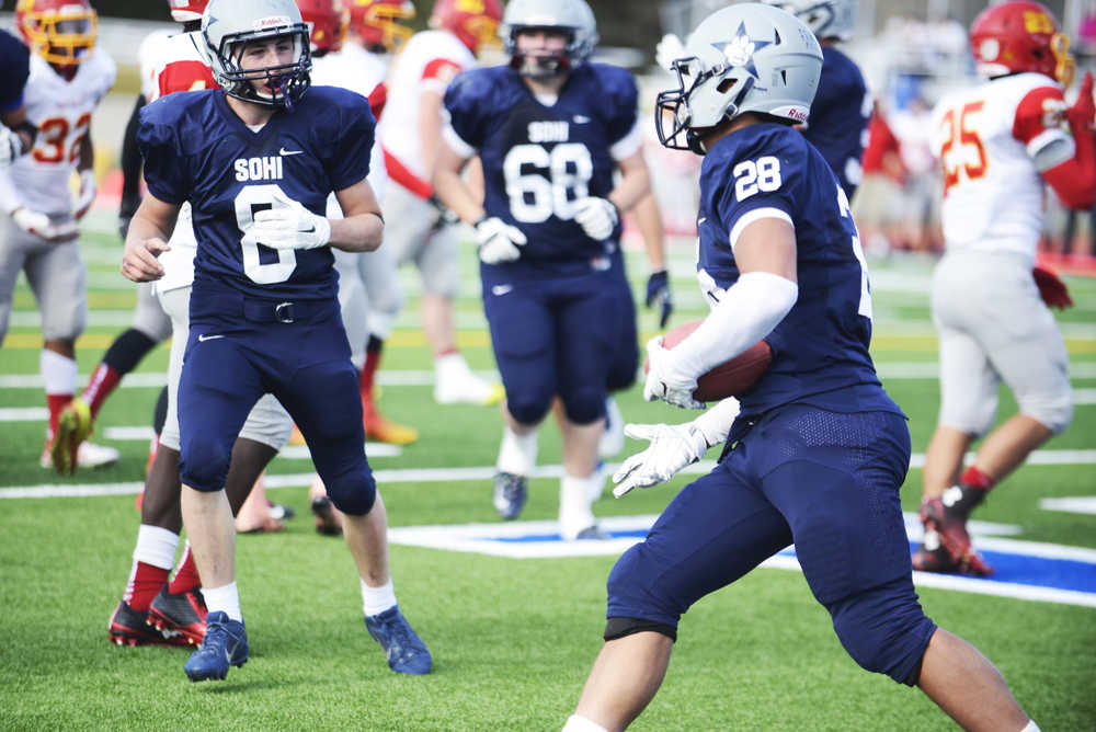Photo by Kelly Sullivan/ Peninsula Clarion Soldotna Stars Jared Chavez reacts to Drew Gibbs touchdown in the game against Faribanks' West Valley Wolf Pack, Saturday, September 27, 2014 at Soldotna High School in Soldotna, Alaska.