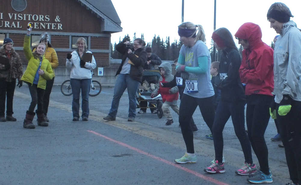 Ben Boettger/Peninsula Clarion Participants gather at the starting line for Emma's Run at the Kenai Visitors Center on Saturday, Nov. 22.