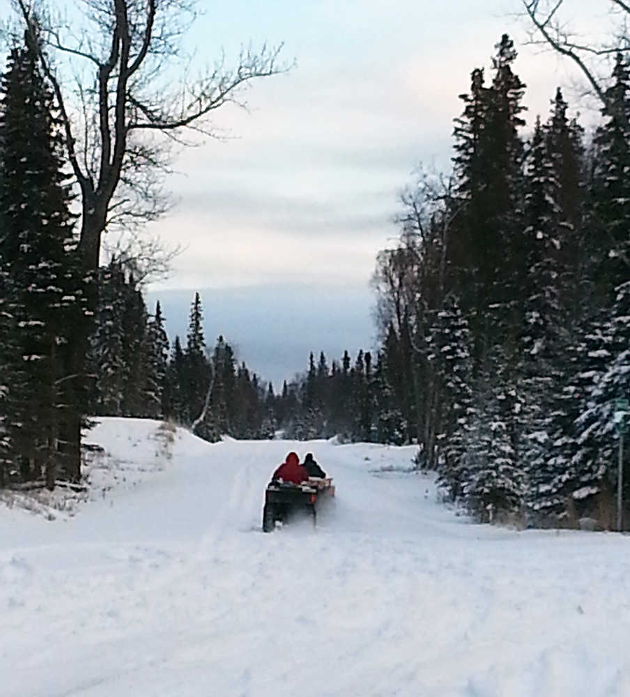 Photo by Dan Balmer/Peninsula Clarion Two Gray Cliffs property owners take off on all-terrain vehicles at the end of the Kenai Spur Highway to access their property Wednesday. The property owners said they cannot get to their land by vehicle because of the rough terrain. Apache Alaska Corporation has proposed a 7.5-mile extension of the Spur Highway to the Gray Cliffs subdivision that would benefit their oil and gas exploration as well as property owners.