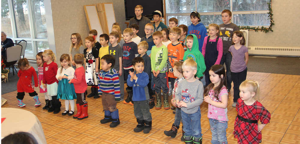 Keeping a 20-year-old tradition Cook Inlet Academy students go caroling in Kenai