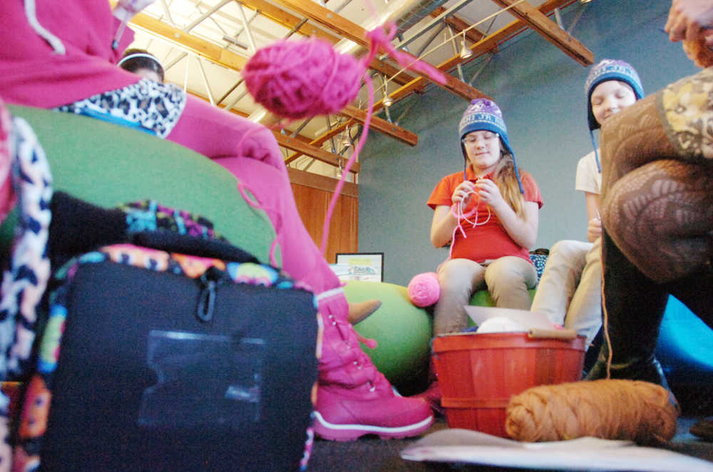 Photo by Kelly Sullivan/ Peninsula Clarion Valerie Federer focuses on her project, Monday, Feb. 2, 2015, at the Kenai Community Library in Kenai, Alaska.