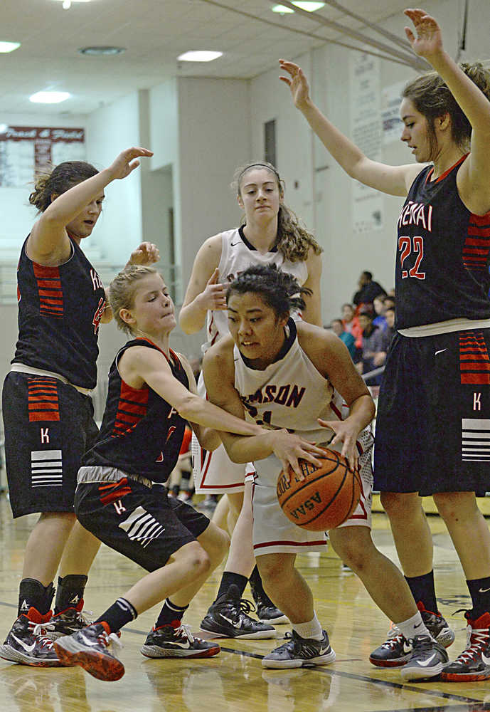 Kenai's Allie Ostrander fights for a ball with Juneau-Douglas' Rachelle Roldan as the Kardinals' Sarah Every and Alexis Baker (22) and Crimson Bears Cassie Dzinich look on during the Kardinals' 34-16 win over the Crimson Bears on Thursday in Juneau.