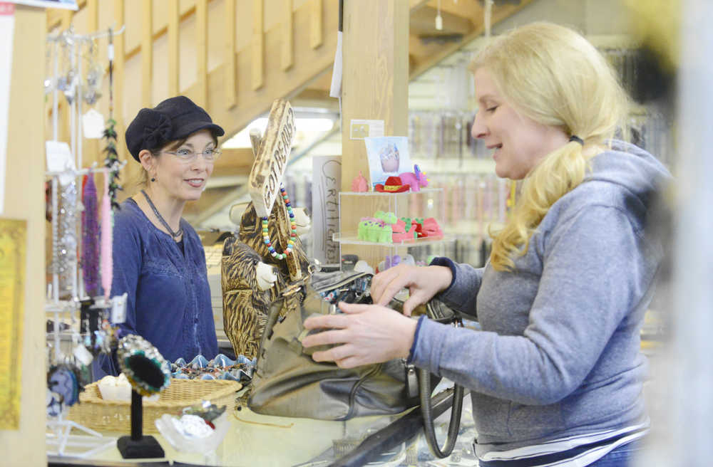 """Photo by Kelly Sullivan/ Peninsula Clarion Elizabeth Ward, who owns 'Bead It' with her husband Jimmy Ward, chats with Amiel Severson Monday, Feb. 16, 2015, in Soldotna Alaska. Severson said she comes consistently but refers to herself as an """"irregular"""" customer."""