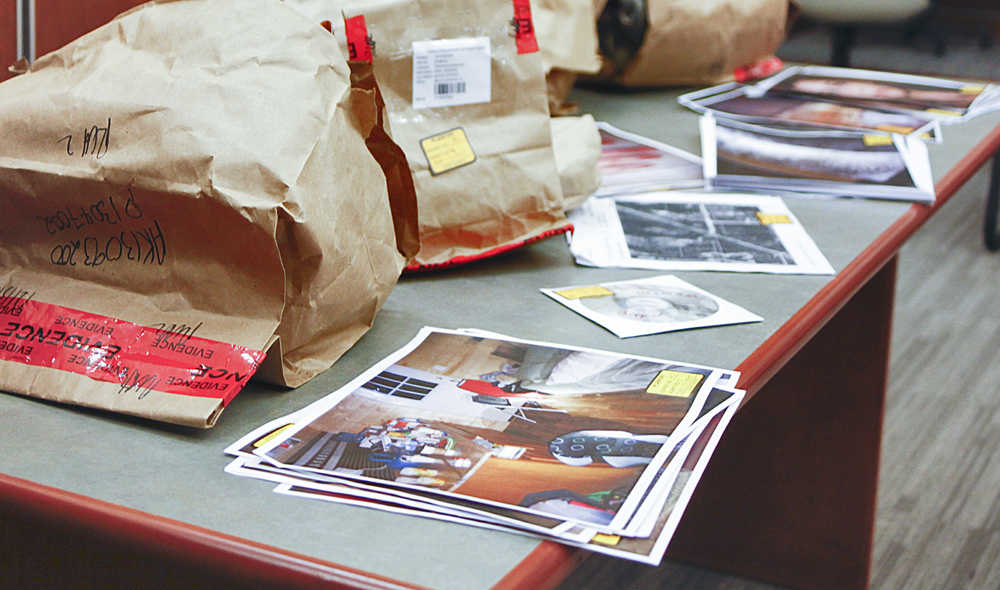 Photo by Rashah McChesney/Peninsula Clarion Evidence bags and photographs pile up on an exhibit table during the attempted rape, burglary and assault trial against Soldotna man Shane Heiman, on Wednesday April 15, 2015 in Kenai, Alaska.