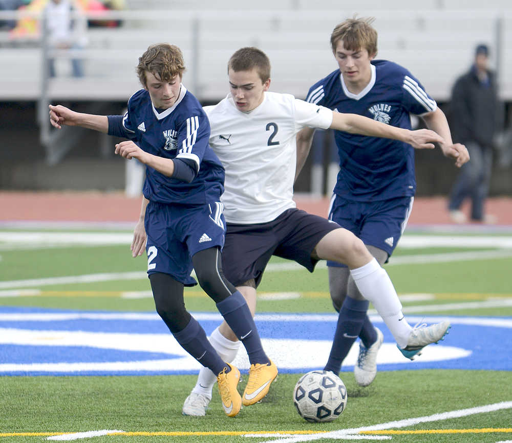 Photo by Rashah McChesney/Peninsula Clarion (left) Soldotna high school's Thomas Flores, Eagle River's Seth Hard and Soldotna's Dylan Kuntz tangle during their game on Friday April 24, 2015 in Soldotna, Alaska.