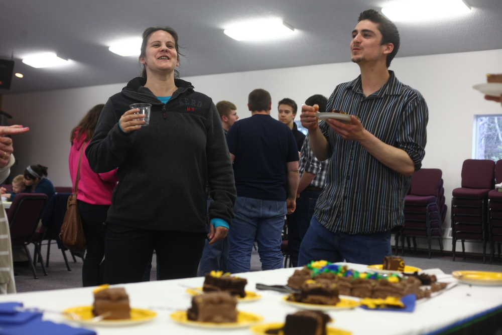 Photo by Kelly Sullivan/ Peninsula Clarion William Roth (right) discusses his post graduation plans at the IDEA home schooling support program's 2015 graduation ceremony Tuesday, May, 5, 2015, at the Kalifonsky Christian Center in Kenai, Alaska.