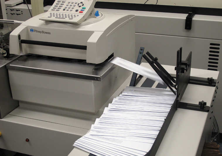 Notices warning state employees of potential layoffs if a fully funded budget is not approved by July 1 were being prepared for mailing at a state office building on Monday, June 1, 2015, in Juneau, Alaska. (AP Photo/Becky Bohrer)