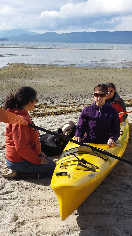 """Participants in Perseverance Theatre's """"Theatre in the Wild"""" program get comfortable in a kayak last year. The theatre is now signing up interested high school students for this year's camp, scheduled for Aug. 3 - Aug. 8."""
