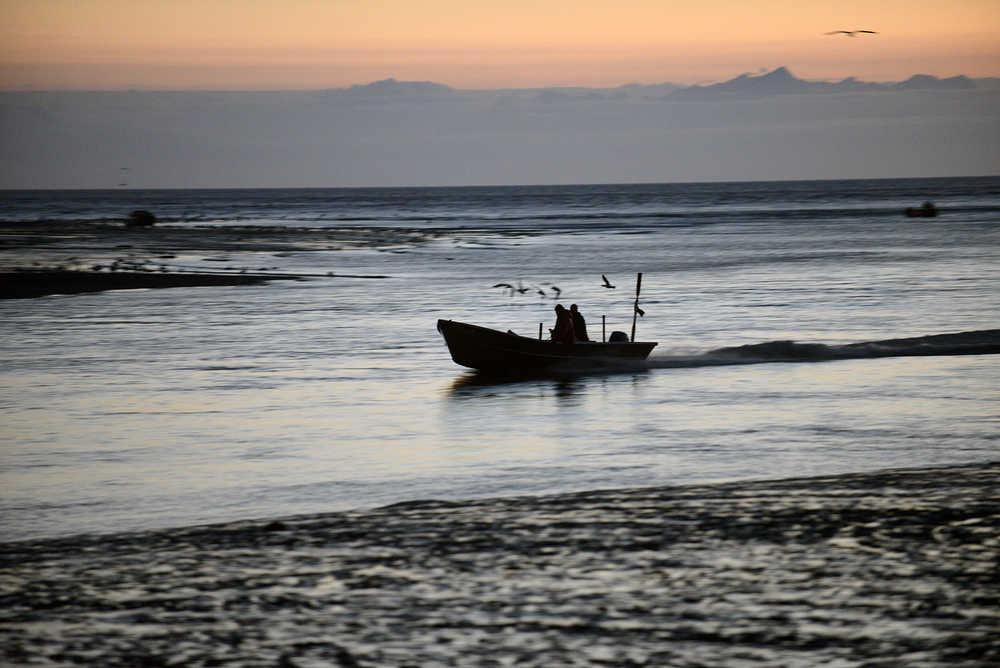 Photo by Rashah McChesney/Peninsula Clarion A setnet skiff races up the Kasilof River during the first overnight fishing period in the Kasilof Special Harvest Area at the mouth of the river on July 7. Personal use dipnetters, commercial setnet and drift gillnet fishermen crowd into a two mile area around the mouth of the river when the special harvest area is opened.
