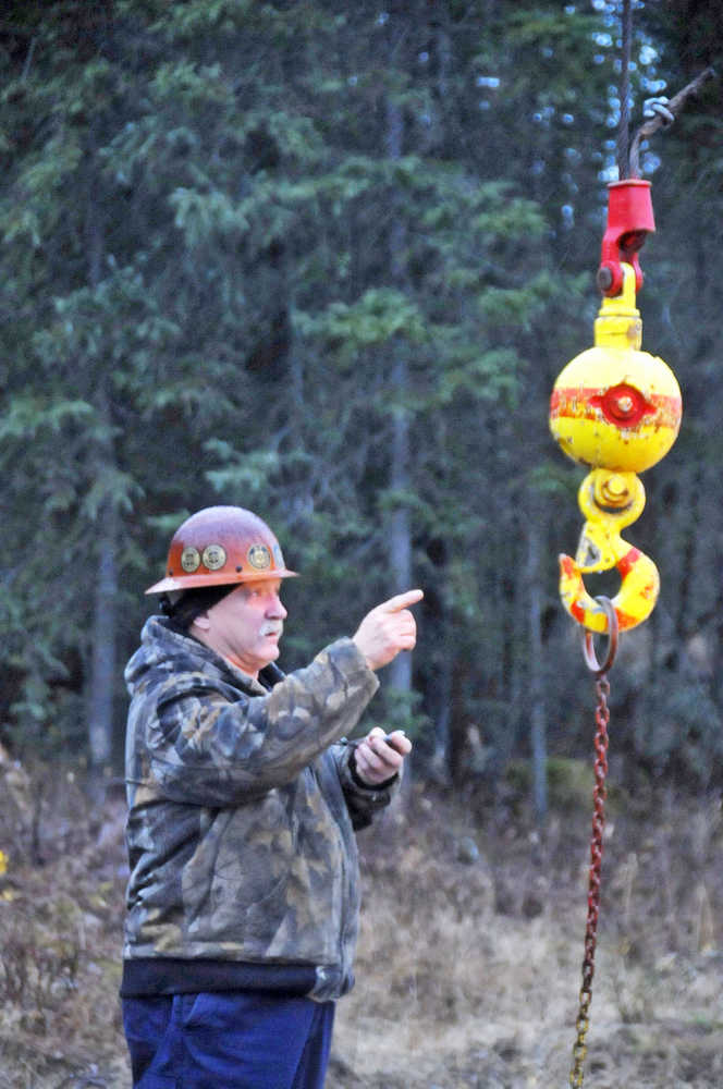 Bill Elmore, the owner of Alaska Crane Consultants, administers a practcal exam Friday morning.