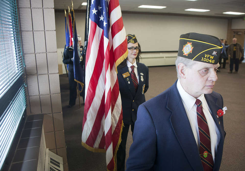 Photo by Rashah McChesney/Peninsula Clarion Members of Kenai's American Legion Post 20 salute during the posting of the colors at a Veterans Day ceremony on Wednesday Nov. 11, 2015 in Soldotna, Alaska.