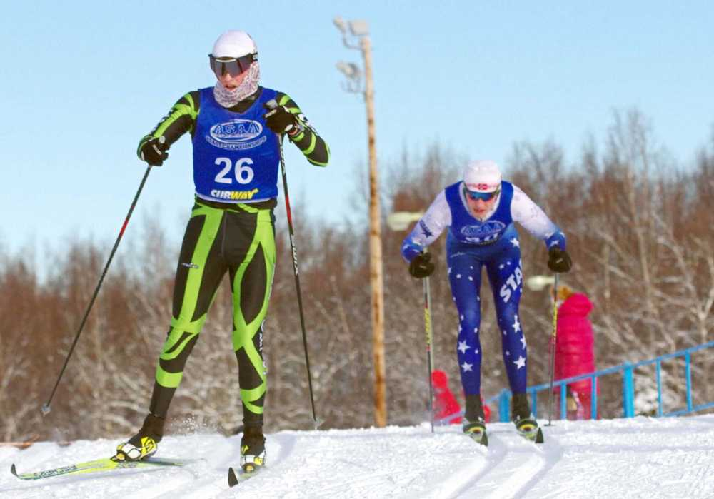 Colony's Tracen Knopp skis just ahead of Soldotna's Levi Michael during the 10-kilometer classic race of the ASAA/First National Bank State Cross-Country Ski Championships at Kincaid Park in Anchorage Friday.