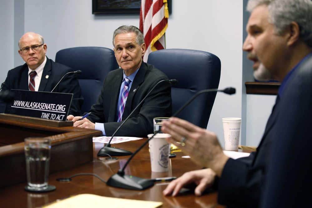 State Sen. John Coghill, left, R-North Pole, and Senate President Kevin Meyer, middle, listen as state Sen. Pete Kelly, R-Fairbanks, speaks during a news conference, Tuesday, Jan. 19, 2016, in Juneau, Alaska, prior to the start of the 2016 legislative session. Republican leaders said they would focus on budget cuts and cost-saving measures to major programs as the state faces a $3.5 billion budget deficit. (AP Photo/Rashah McChesney)