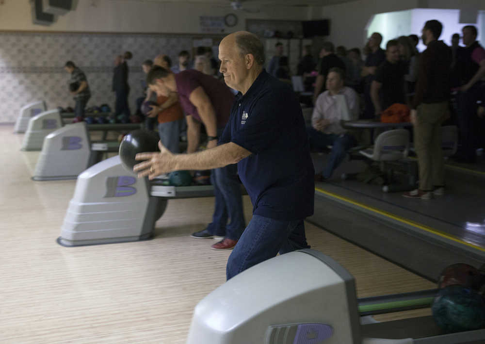 In this Feb. 4, 2016, photo, Alaska Gov. Bill Walker bowls with fellow legislators and staff in Juneau, Alaska. It was his first night of bowling with the legislative bowling leagues. Bipartisan, bicameral bowling has been a staple of Alaska's legislative session for nearly 30 years. (AP Photo/Rashah McChesney)