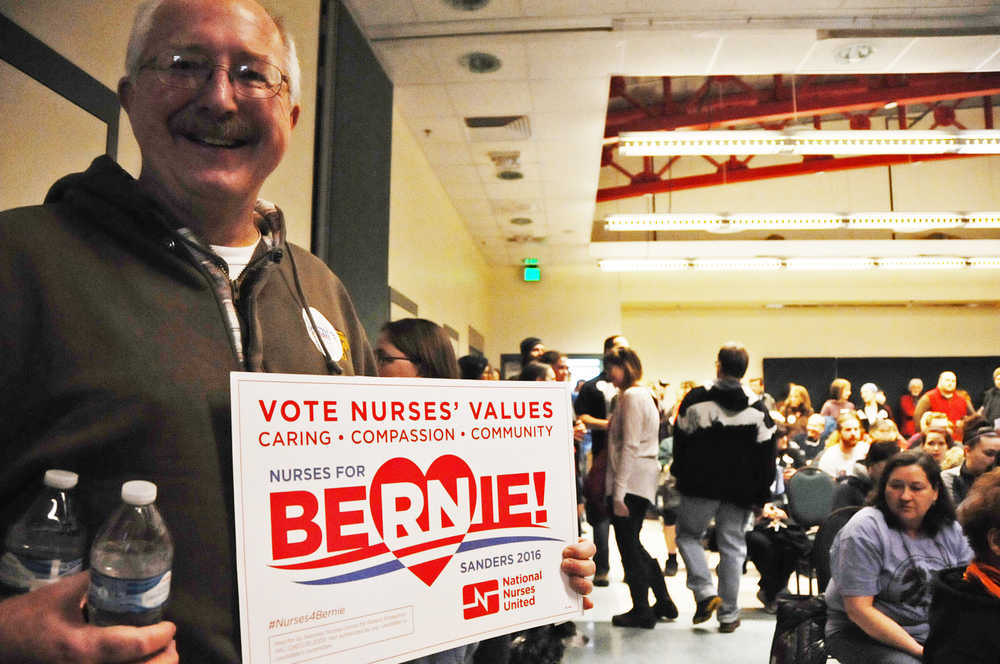 Photo by Elizabeth Earl/Peninsula Clarion Randall Knowles turned out to the Democratic caucus at Kenai's Challenger Learning Center Saturday morning to support Bernie Sanders.