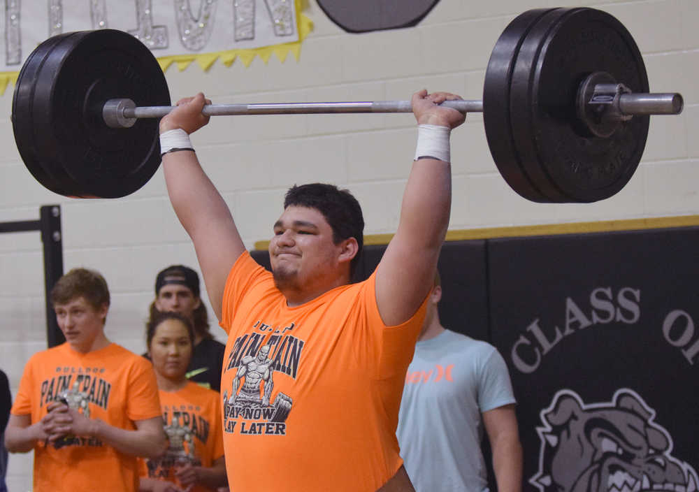 Photo by Jeff Helminiak/Peninsula Clarion Nikiski senior Ruben Sepeda competes in the snatch at the Speed and Strength Training competition Wednesday at Nikiski High School.
