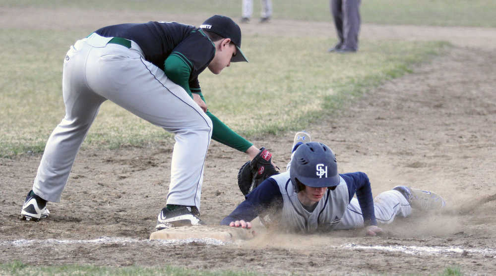 Soldotna's Caleb Spence slides underneath the tag of Colony first baseman Zachary Sattetly during a win over the Knights May 6, 2016, at the Palmer Senior Field in Palmer.