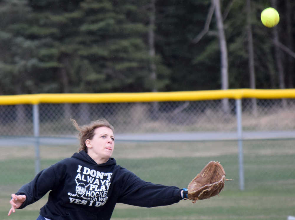 Photo by Jeff Helminiak/Peninsula Clarion Soldotna right fielder Alicia McClelland can't catch up to a triple by Kenai Central's Darcy Blume in the bottom of the second inning Wednesday, May 11, 2016, at Steve Shearer Memorial Ball Park in Kenai.