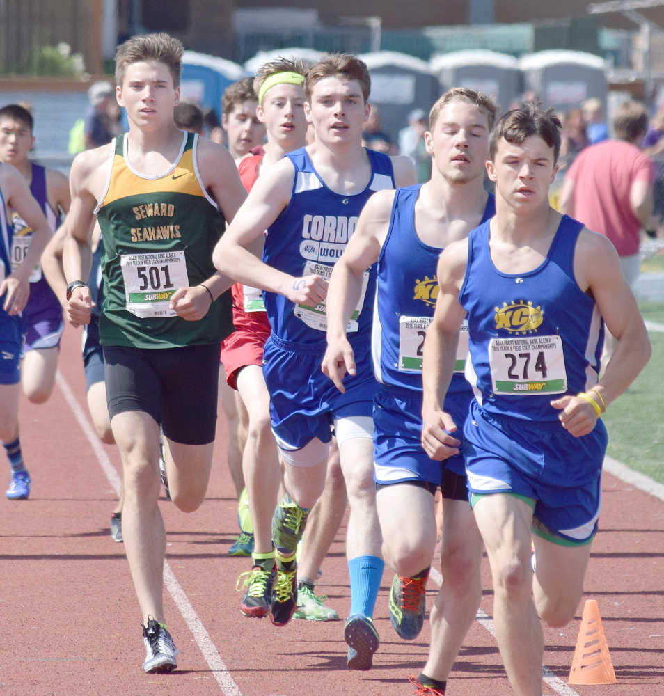 Photo by Joey Klecka/Peninsula Clarion Seward runner Hunter Kratz (501) races with a pack of contenders, including leader Kaleb Korta of Galena, in the 1-2-3A boys 1,600-meter race Saturday at the state track and field championships at Dimond Alumni Field in Anchorage.