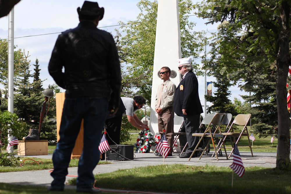 Photo by Kelly Sullivan/ Peninsula Clarion Audience members stayed silent during the laying of the wreaths and poppies during the Memorial Day at Leif Hansen Memorial Park on Monday, May 30, 2016, in Kenai, Alaska.