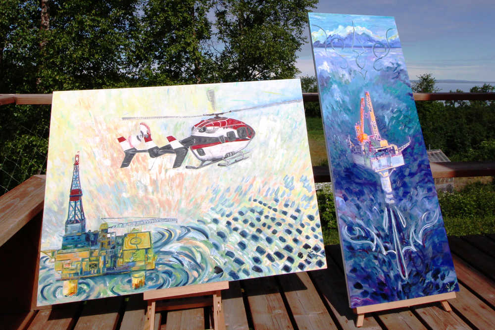 Louise Nutter's paintings of the XTO A oil platform (left, now owned by Hilcorp) and Furie Energy's Julius R platform stand on the deck of her house on Wednesday, June 1 in Nikiski. 10 platforms, including the A and the Julius, are visible from the deck where Nutter sometimes works. Her platform paintings are based on photographs she took while flying over Cook Inlet.