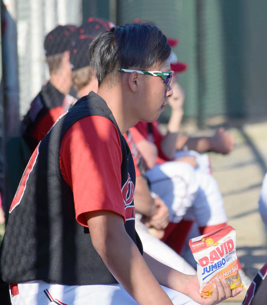 Photo by Joey Klecka/Peninsula Clarion Yi-Hsin Huang scouts out the opposition between pitching stints against the Alaska Goldpanners of Fairbanks June 14 at Coral Seymour Memorial Park in Kenai.