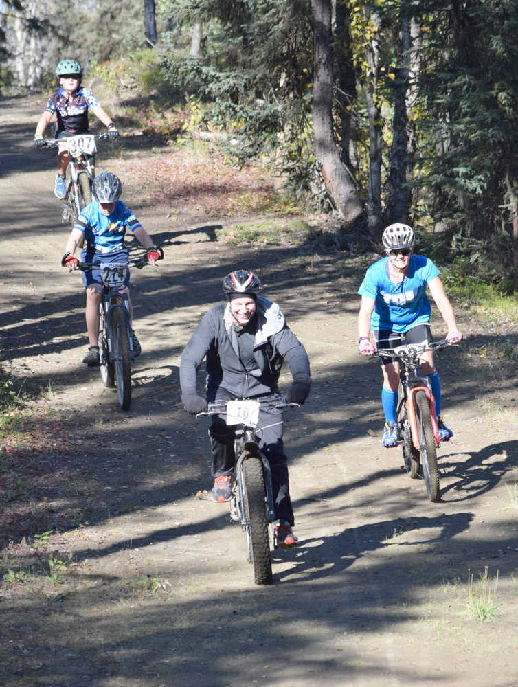 Photo by Jeff Helminiak/Peninsula Clarion Carl Kincaid leads Ashley Tonione, Dylan Hogue and Landen Showalter down the beginning of the Goat loop Saturday at Tsalteshi Trails during Psychocross.