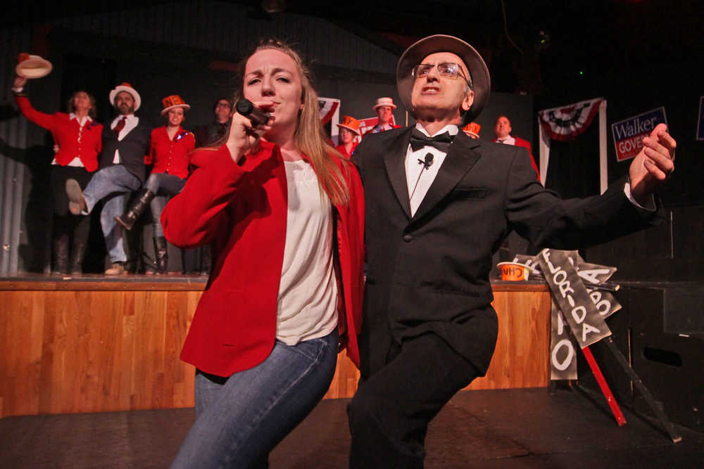 """Photo by Ben Boettger/Peninsula Clarion Hannah Tauriainen and Joe Rizzo open up the Triumvirate Theatre's """"Lame Ducks and Dark Horses"""" political satire play with a song backed by a chorus line during a dress rehearsal Monday, Oct. 24, 2016 near Kenai, Alaska."""