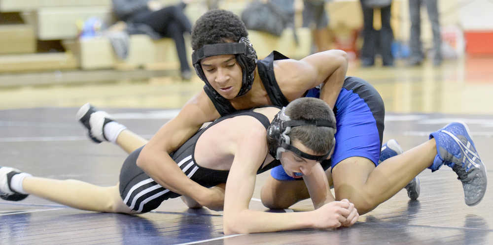 Photo by Jeff Helminiak/Peninsula Clarion Soldotna's Ben Booth controls Nikiski's Joey Yourkoski in an exhibition match at 106 pounds Wednesday at Soldotna Prep. Booth scored a 16-4 major decision.