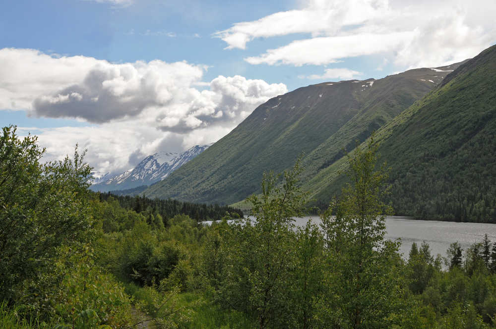 Photo by Elizabeth Earl/Peninsula Clarion In this June 2016 photo, the clouds mass over the mountains around Lower Russian Lake near Cooper Landing, Alaska. The conservation nonprofit Cook Inletkeeper recently installed a temperature sensor on the Russian River below Lower Russian Lake to keep track of the river's temperatures on a real-time basis.