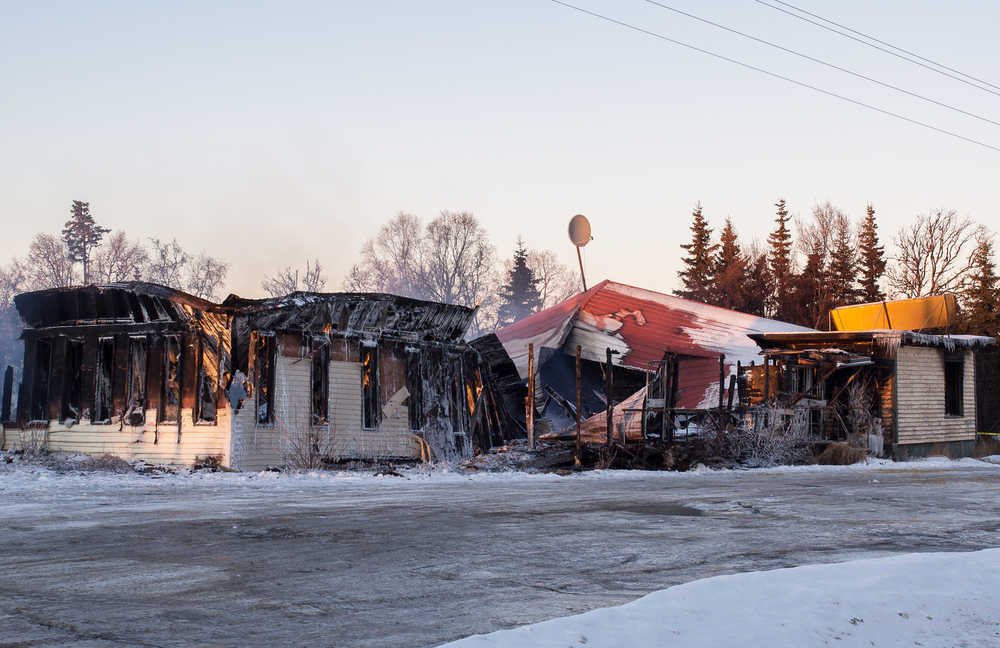 Photo courtesy Joe Kashi The remains of the Clam Shell Lodge continue to burn slightly where the establishment, closed in 2011, once stood in this photo taken Saturday, Jan. 7, 2017 in Clam Gulch, Alaska. The building burned down Friday night.