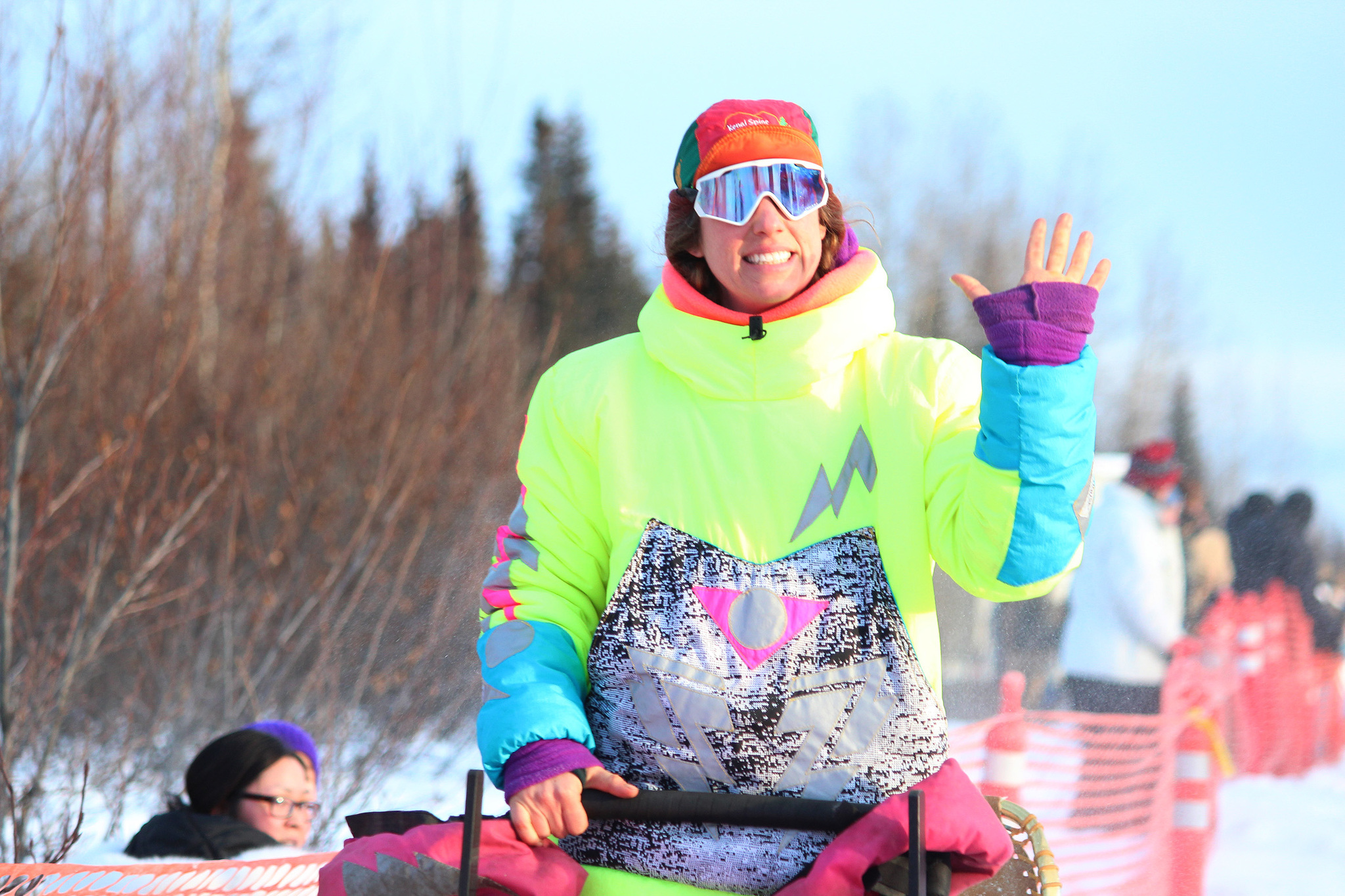 Musher Monica Zappa waves to onlookers as she and her team of dogs take off from the starting line of this year's Tustumena 200 Sled Dog Race on Saturday, Jan. 28, 2017 in Kasilof, Alaska. Zappa and 22 other mushers will travel with their dogs through the Caribou Hills to Homer and back in the 200-mile race. (Megan Pacer/Peninsula Clarion)