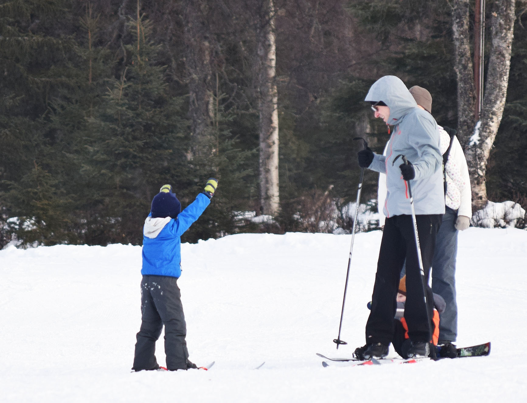 A young skier romps around with his family, Jan. 28 at the Kenai Golf Course. (Photo by Joey Klecka/Peninsula Clarion)