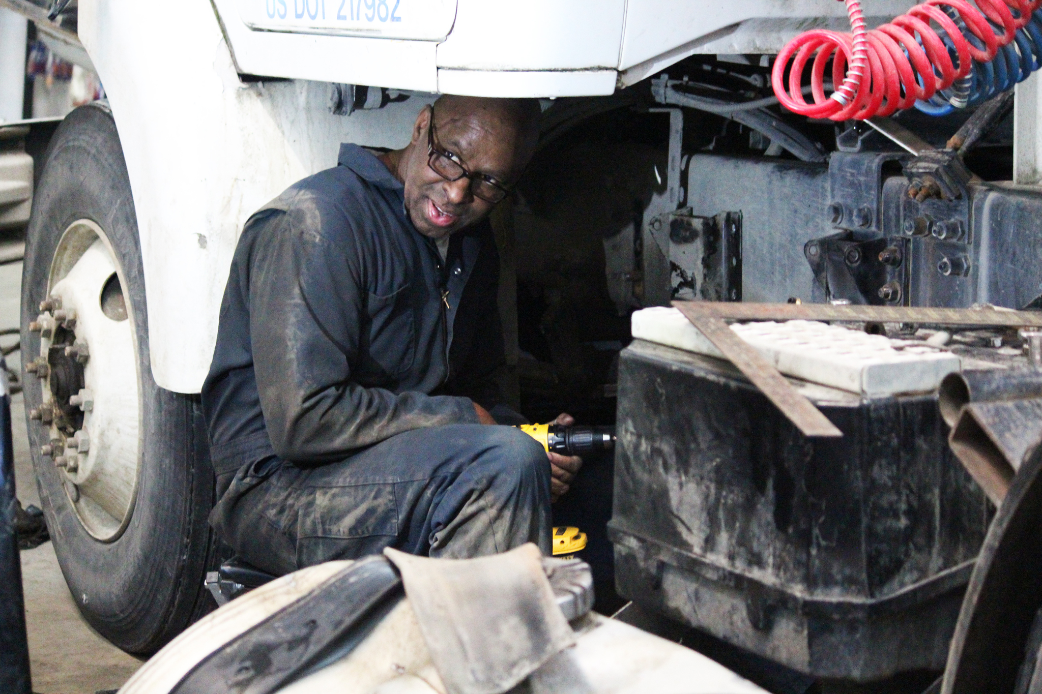 Thaddeus Lewis turns to his boss, Lee Berzanske, while drilling holes in an Enstar Natural Gas Co. truck during their work day Thursday, Feb. 16, 2017 at Lee's Heavy Equipment Repair on Kalifornsky Beach Road near Kenai, Alaska. Lewis, an inmate at Wildwood Correctional Complex, was the first offender admitted into the facility's new Vocational Work Release Program. (Megan Pacer/Peninsula Clarion)