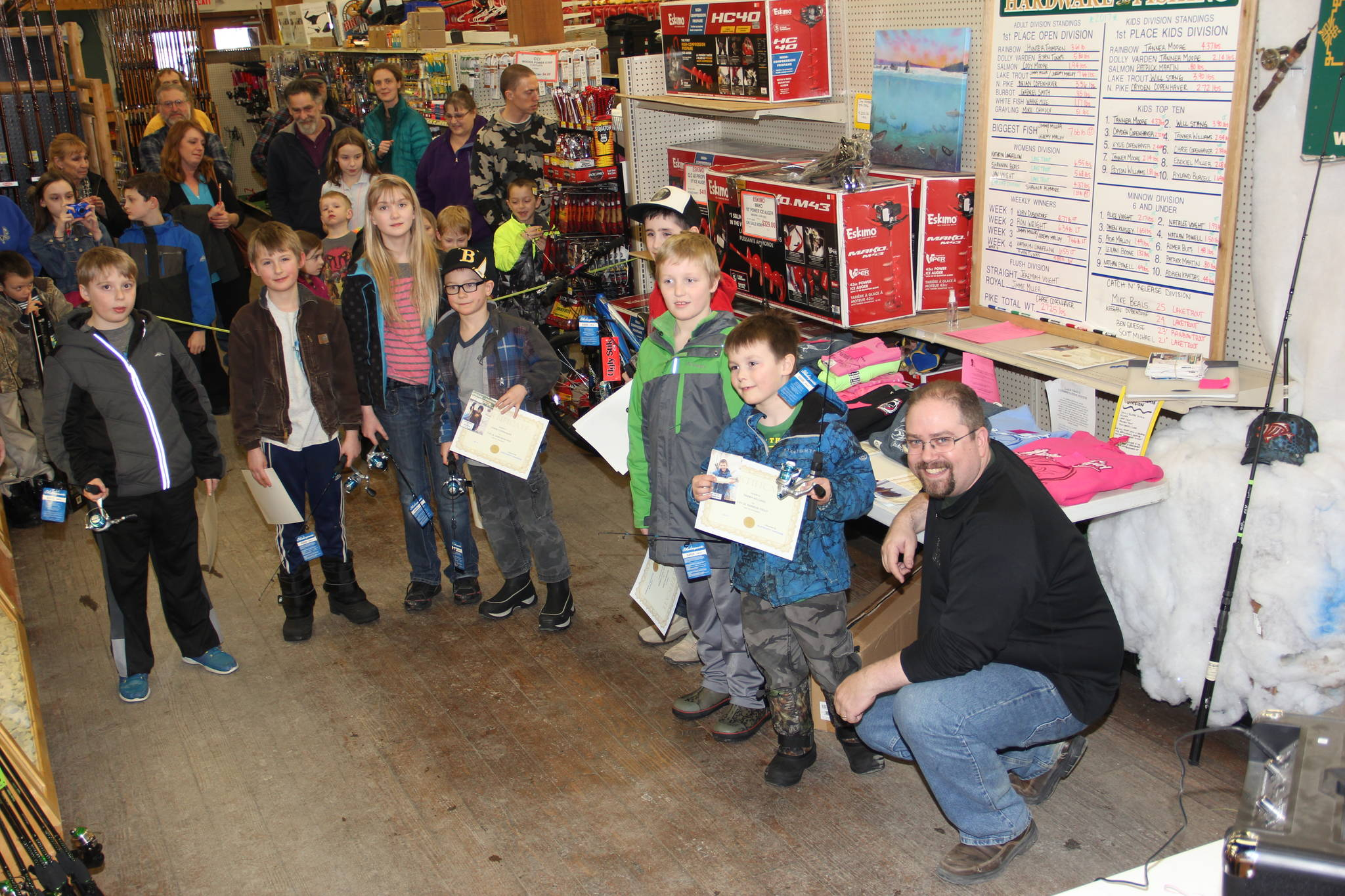 Trustworthy co-owner Scott Miller presents kid's division winners with prizes and certificates.