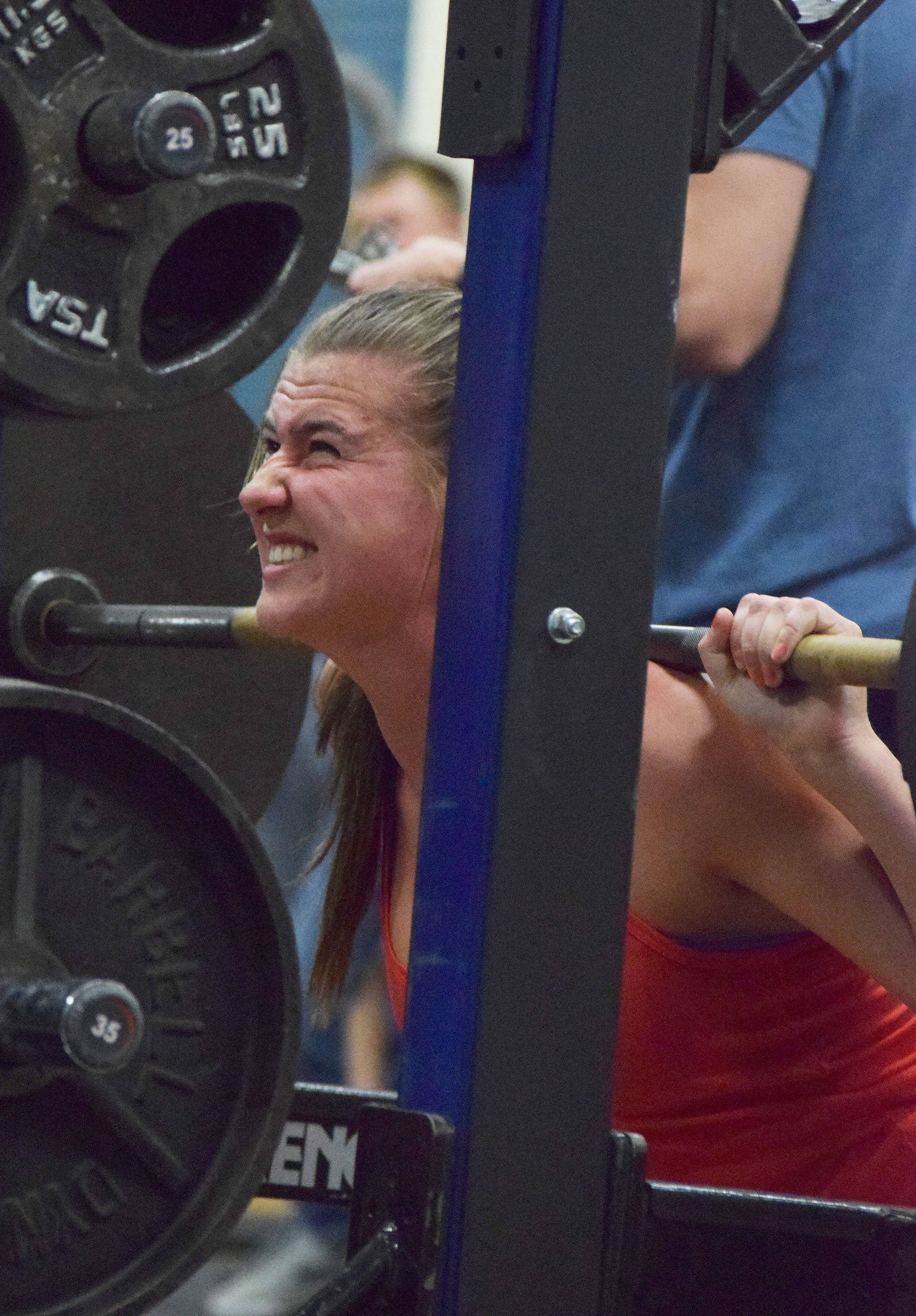 Kenai Central sophomore Olivia Brewer squats Wednesday evening at the 11th biannual CrossFit Competition at Soldotna High School. (Photo by Joey Klecka/Peninsula Clarion)