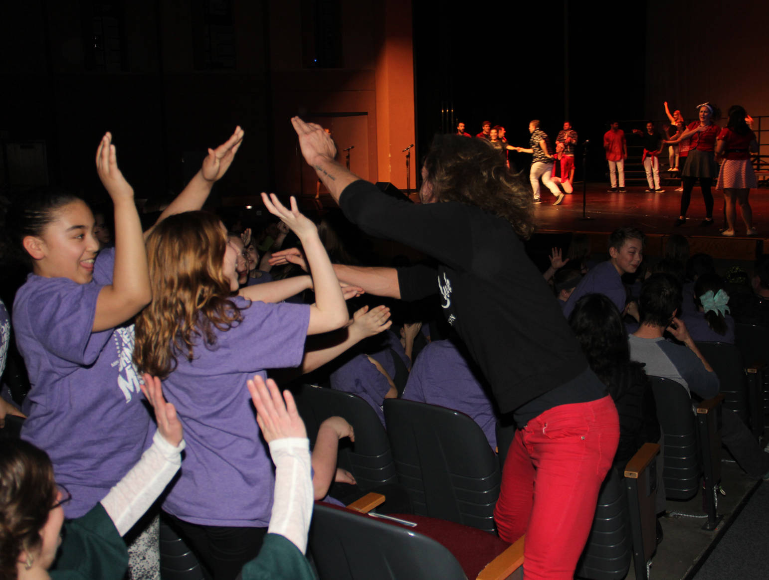 Sharing the energy with their audience Young Americans amaze and inspire Kenai Peninsula Borough School District students.
