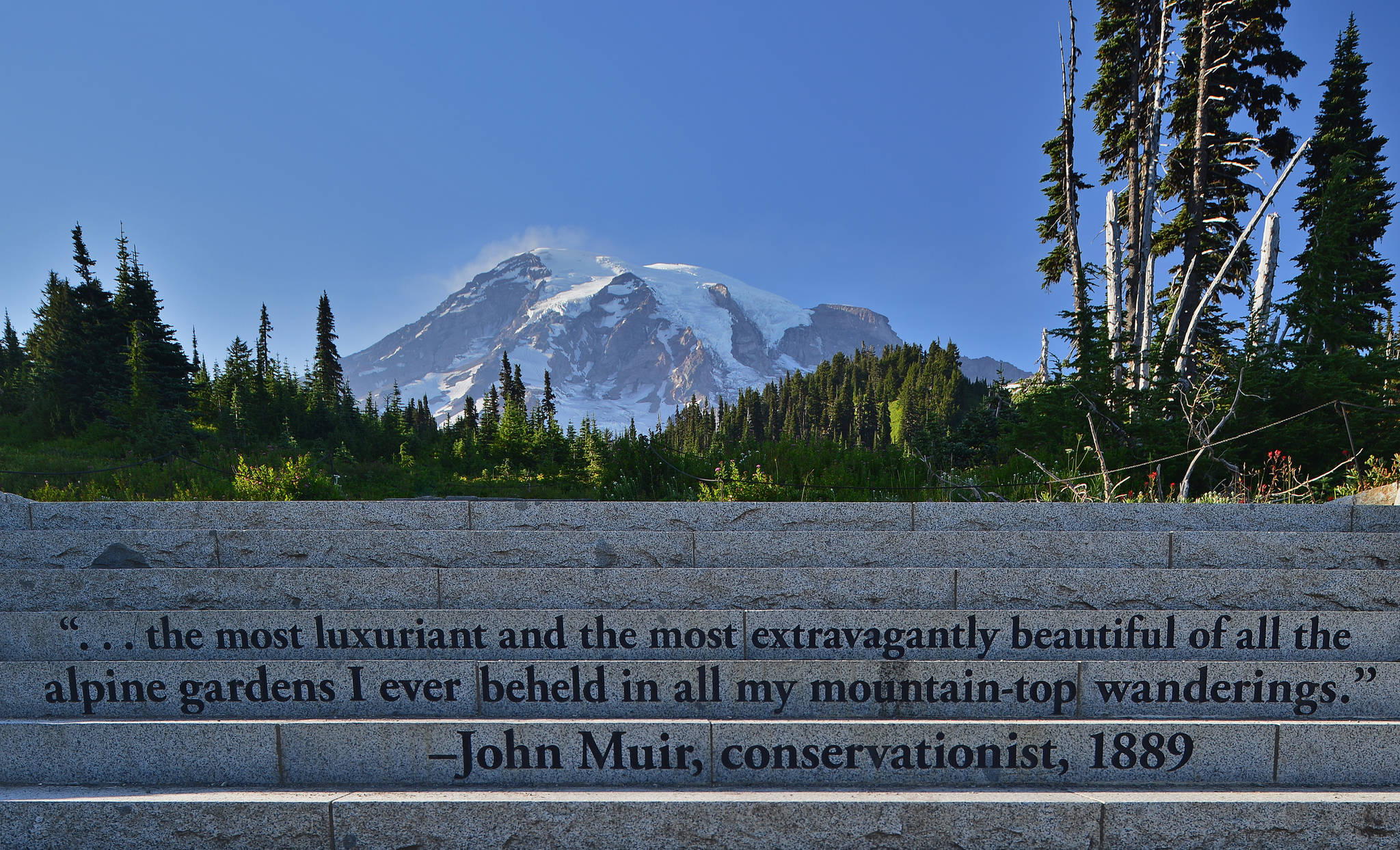 """This Aug. 17, 2016 photo provided by John Chao shows the Muir Steps, Paradise area inside Mount Rainier National Park in Washington. Steps engraved with a quote from famed naturalist John Muir lead up to the Paradise area trails in the park. These are popularly referred to as the """"Muir Steps."""" (John Chao via AP)"""
