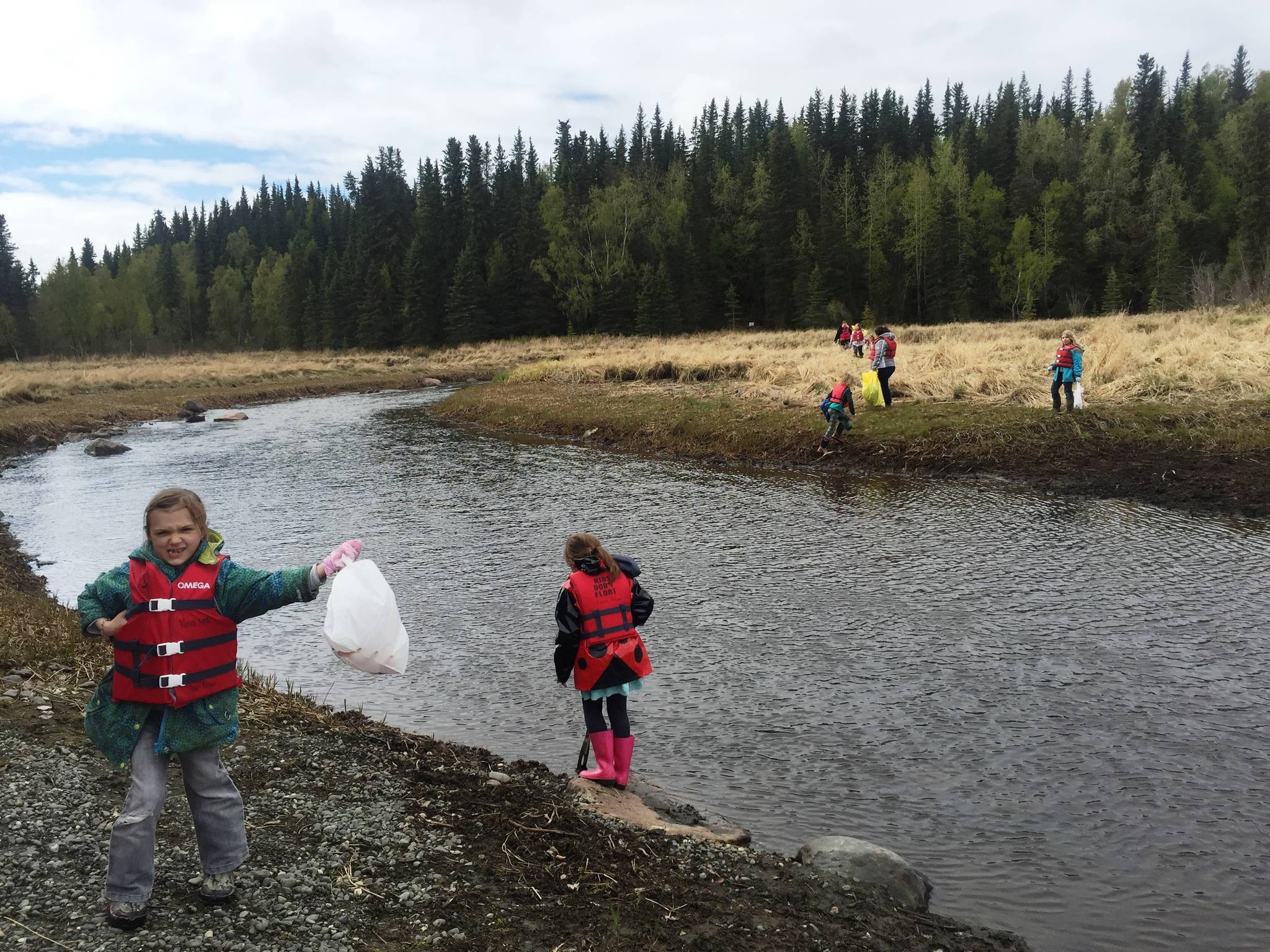 Community groups, like this Girl Scout Troop cleaning up Slikok Creek, help get the Kenai Peninsula ready for summer. (Photo by Leah Eskelin/USFWS)