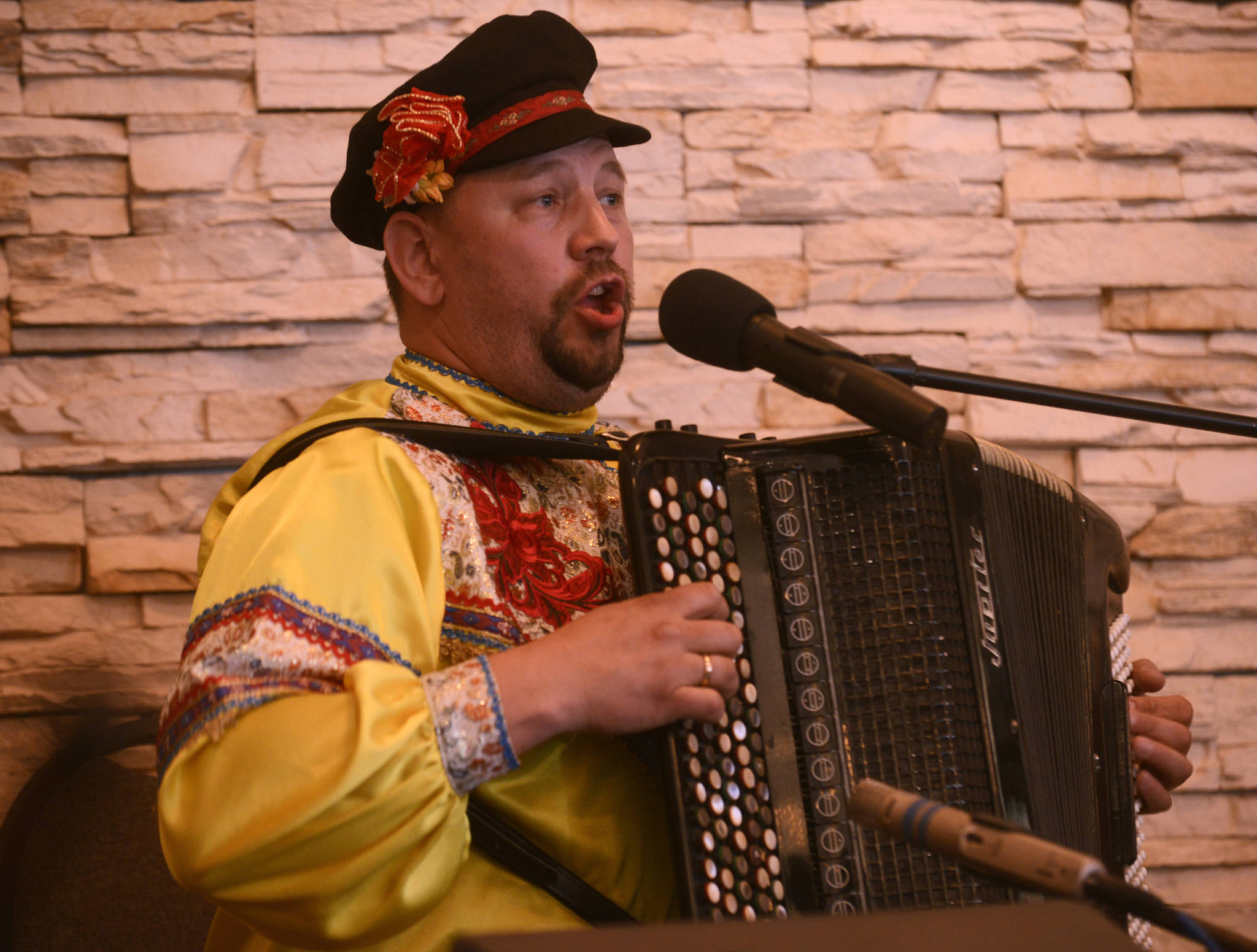 Yuri Shishkin of the Russian folk trio Moscow Nights plays the traditional Russian three-stringed balalaika, with bandmate Boris Bezrodnov on the bass version, on Friday, April 21, 2017 at Alaska Christian College near Soldotna, Alaska. With accordionist Vitali Bezrodnov, the group played for attendees at a Kenai Peninsula History Conference held on the 150th anniversary of Russia's 1867 sale of Alaska to the United States. (Ben Boettger/Peninsula Clarion)