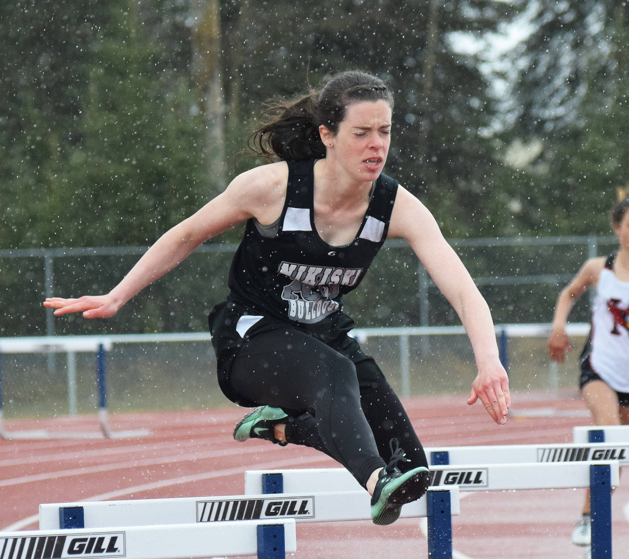 Nikiski senior Crystal Epperheimer leaps a barrier in the girls 300-meter hurdles race Saturday afternoon at the Kenai Peninsula Borough track and field championships at Justin Maile Field in Soldotna. (Photo by Joey Klecka/Peninsula Clarion)