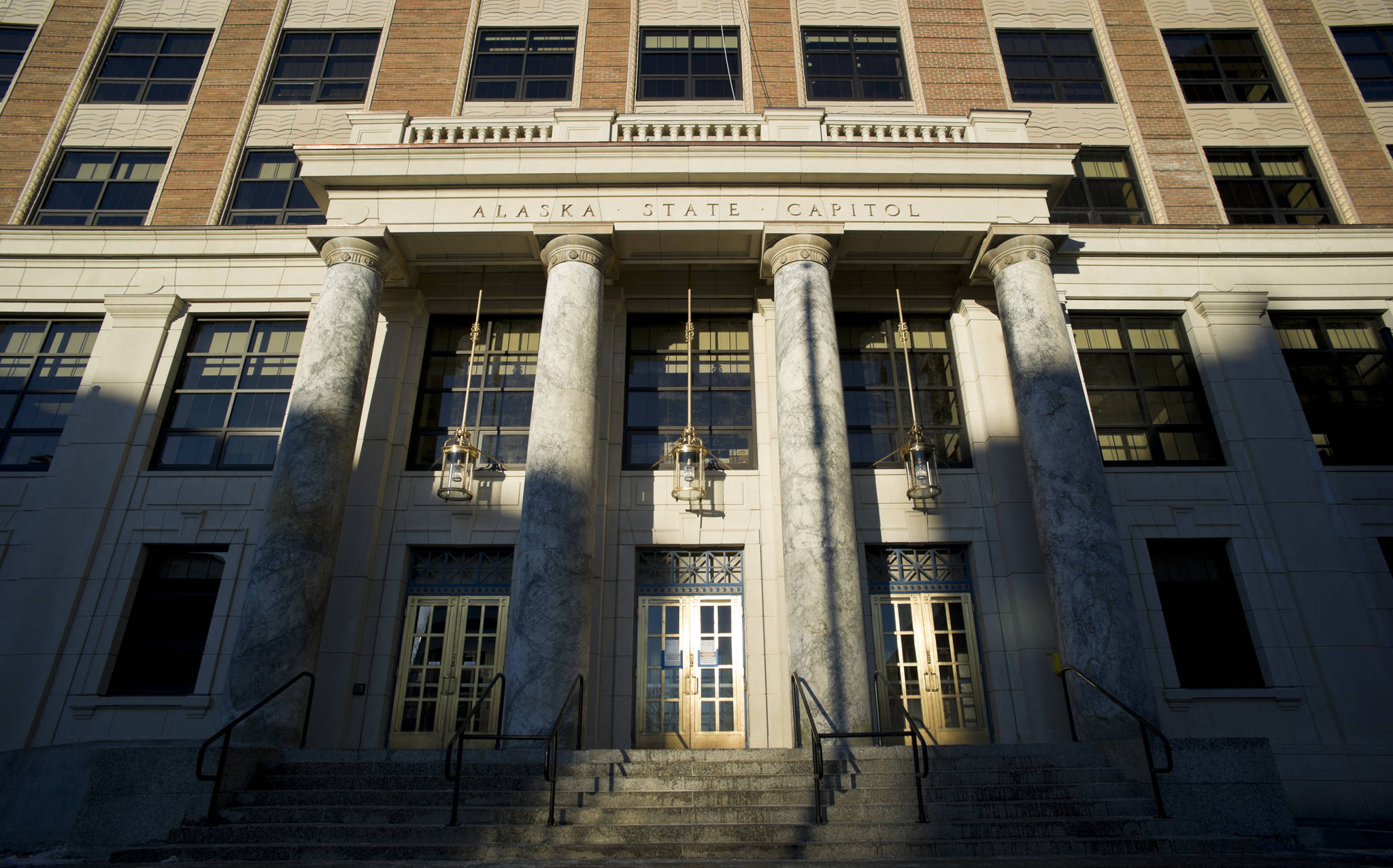 Sunlight exposes the front of the Alaska State Capitol building on Tuesday, Jan. 3, 2017. (Michael Penn | Juneau Empire)
