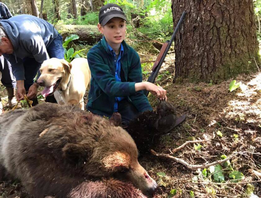 Elliot Clark and family with a brown bear he shot after it charged a group of hunters near Hoonah. (Photo courtesy Sen. Shelly Hughes' Facebook page)